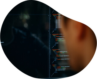 Backend developer writes code for a web application